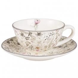 Tasse und Untertasse aus Fayence mit Blumenmotiv