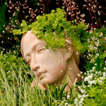 Terracotta-Pflanzgefäß Frauenkopf